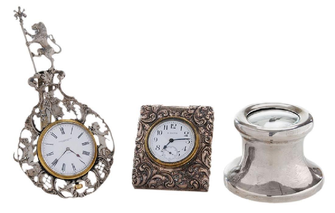 Three Silver Clocks