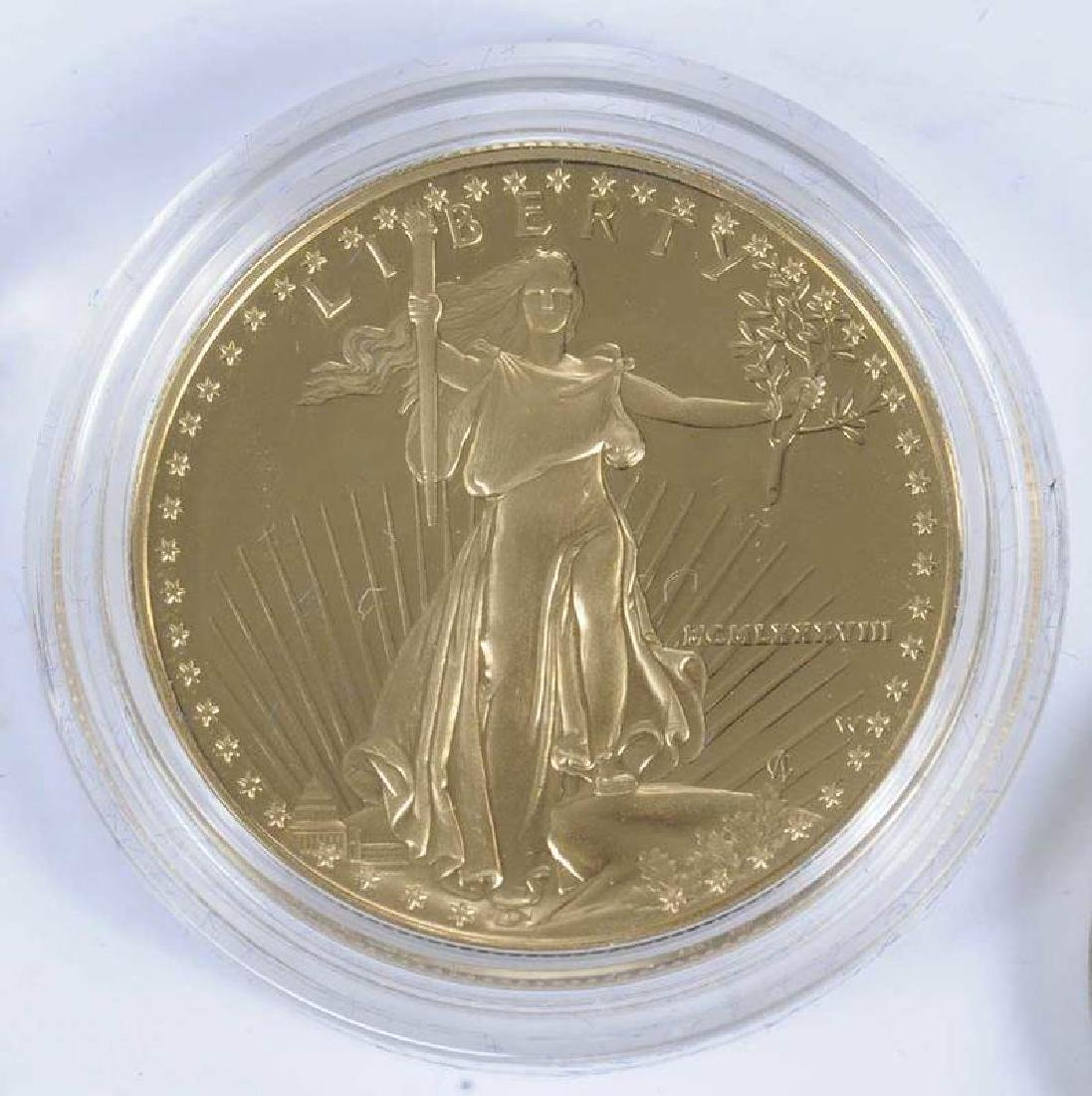 One Gold Ounce 50 Dollar Coin With Other Coins - 2