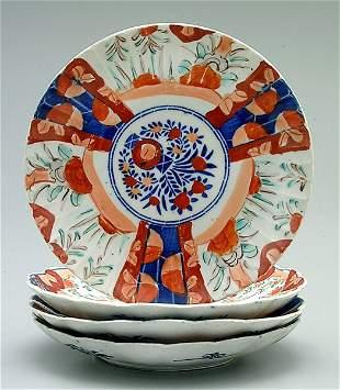 8: Four Imari plates: