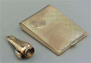 18: Two gold smoking accessories: