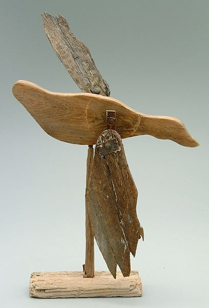 703: Carved and painted whirligig,