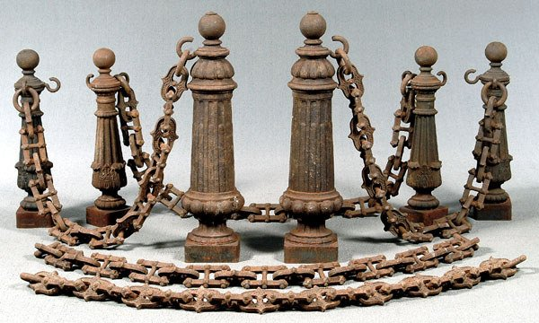 705: Six cast iron posts and chain: