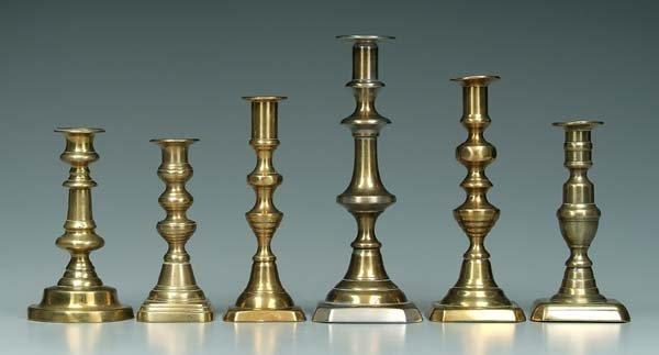 13: Six push-up style brass candlesticks: