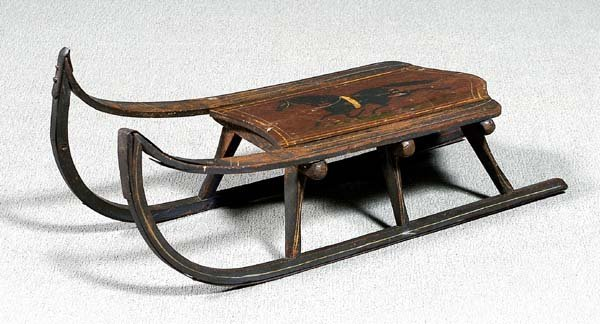 16: Painted wood and iron sled,