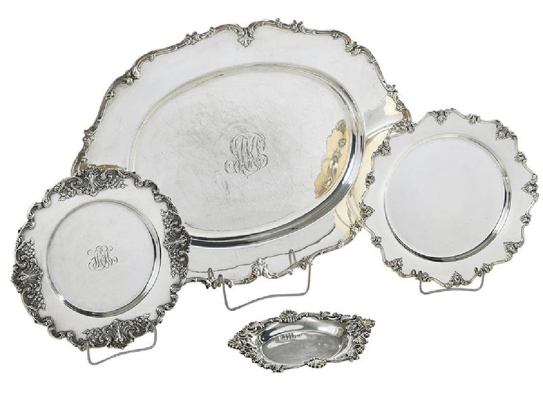 Four Sterling Trays