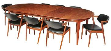 Eight Kai Kristiansen Dining Chairs with Table