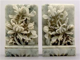 Pair carved hardstone bookends,