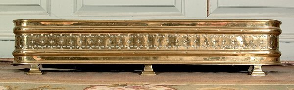 6: Brass fireplace fender,