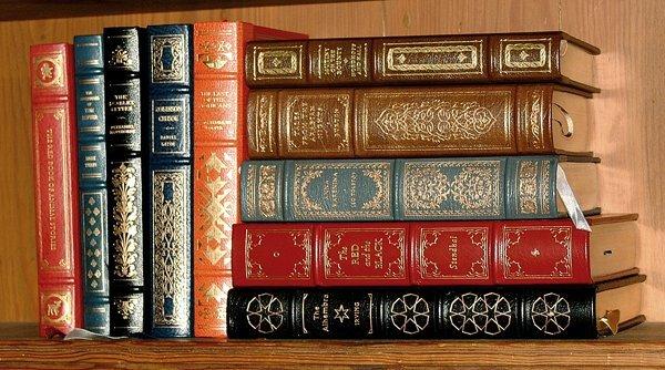 7: Ten leather bound books,