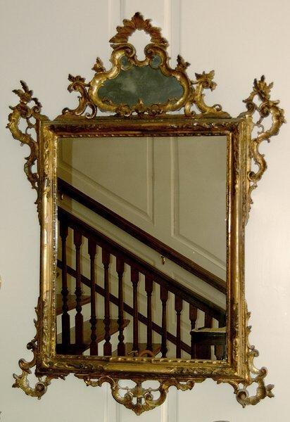 23: Carved gilt wood mirror,