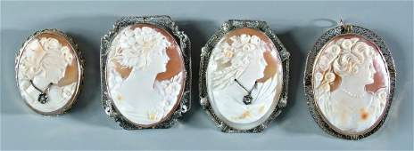 606: Four vintage gold cameo brooches: