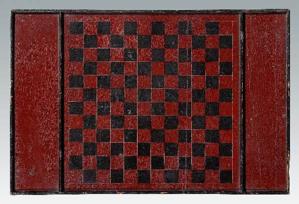 643: Red and black painted game board,