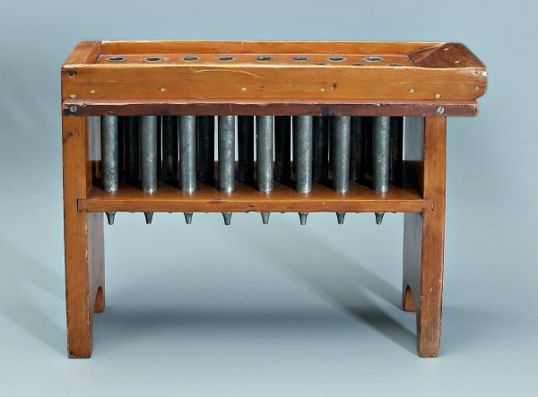 644: Bench type candle mold,