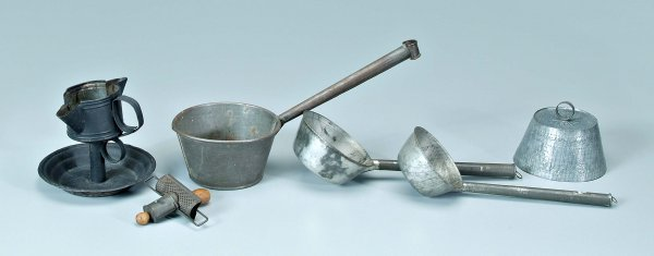 645: Six punched tin kitchen implements: