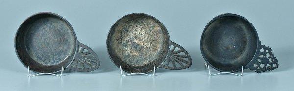648: Three cast iron porringers: