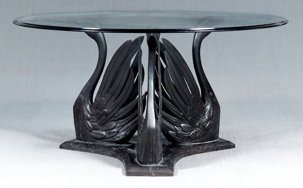 11: Bronze swan form glass top table,