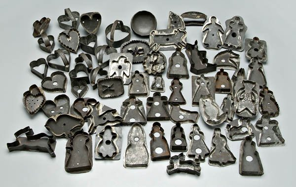 1: Sixty tin cookie cutters: