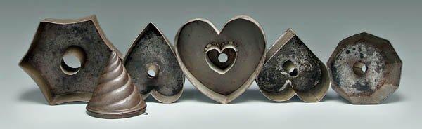 2: Six tin ware molds: