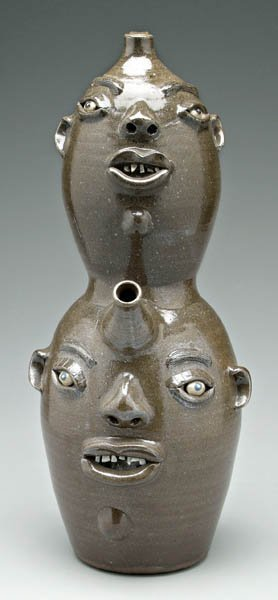 18: Billy Henson double spouted face jug,