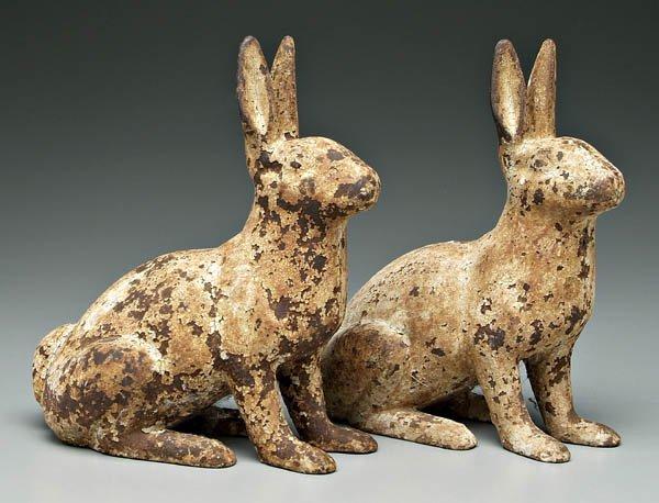 24: Pair cast iron rabbits: