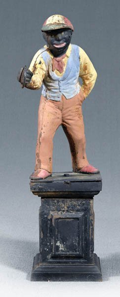 748: Figural cast iron lawn jockey,