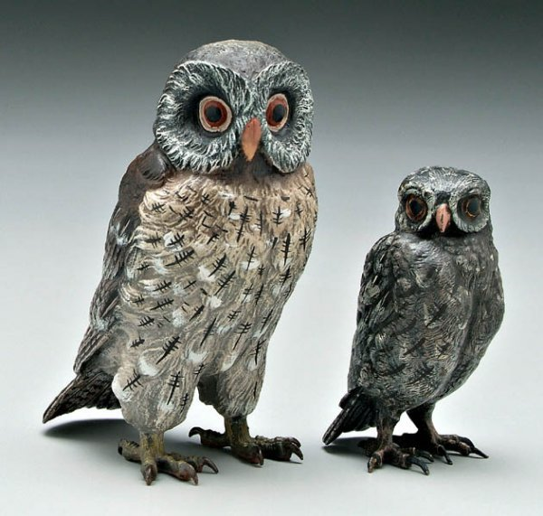 5: Two miniature bronze owls:
