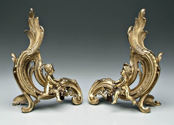 22: Pair brass chenet with [putti]: