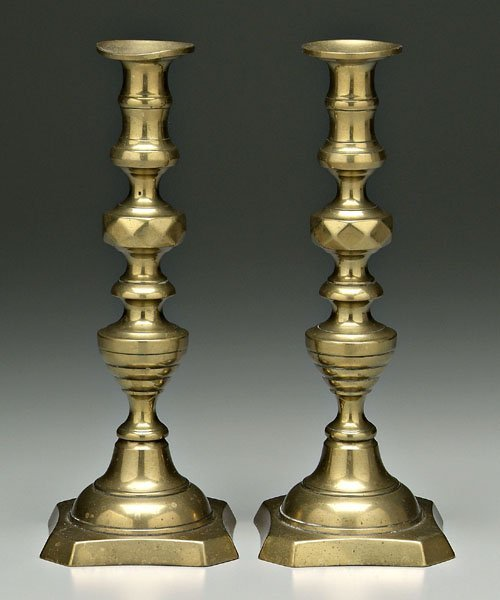 639: Pair brass push-up candlesticks: