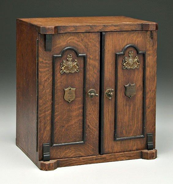 644: British oak smoking cabinet,