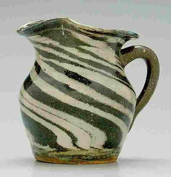 334: Reinhart stoneware swirl pitcher,