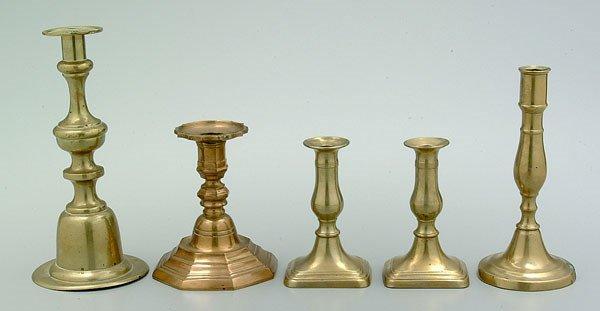653: Five brass candlesticks: