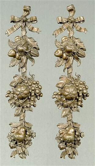 Pair bronze wall decorations