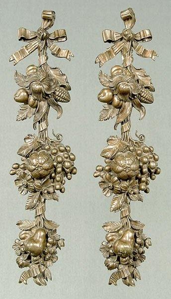 665: Pair bronze wall decorations: