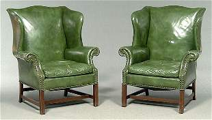 Pair green leather wing chairs,