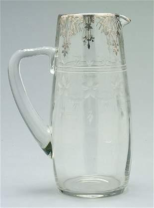 Silver mounted intaglio cut pitcher,