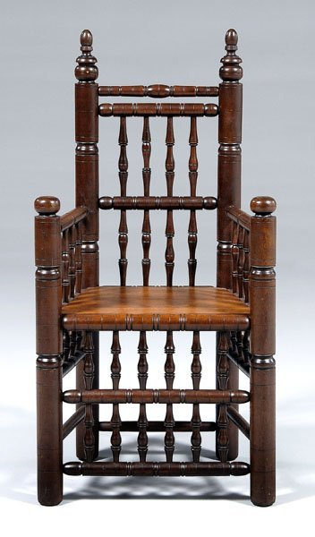 22: Colonial Revival walnut great chair,