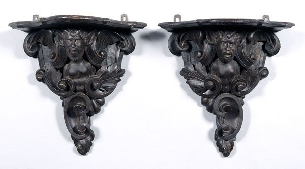 576: Pair carved wood brackets: