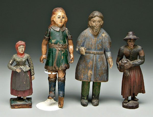 592: Group of four carved wood figures: