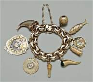 1059: Gold charm bracelet,