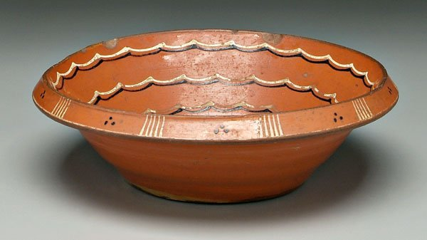1: Slip decorated redware bowl,