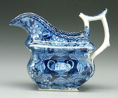 1: Blue transferware creamer, classical figur