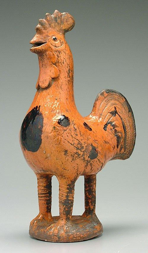 5: Redware rooster, orange and manganese spla