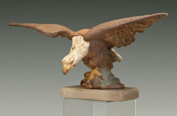 19: Cast iron eagle,