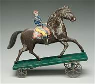 1120: Tin horse and rider pull toy,