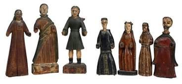 Seven Carved and Polychromed Santos Figures