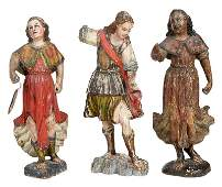 Three Carved and Polychromed Santos Figures