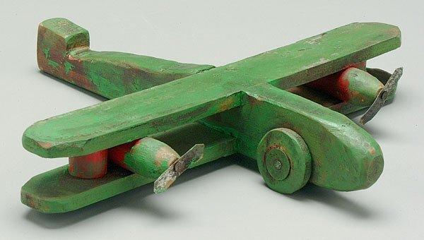 10: Folk art toy biplane,