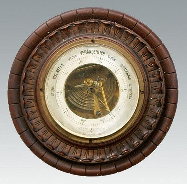 21: Circular German brass barometer,