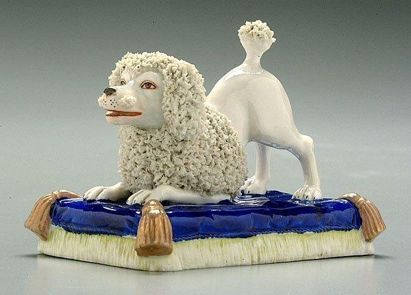 602: Porcelain figure of kneeling poodle,