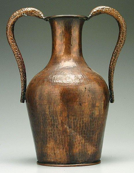606: Hammered copper urn,